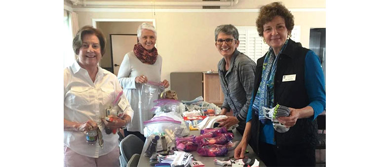 Members filling Purses with necessities for homeless women